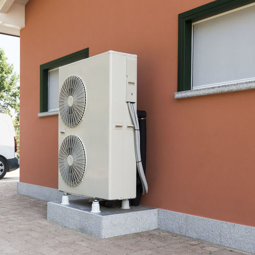 A Heat Pump Outside of a Home.