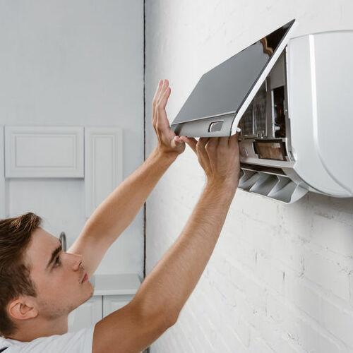 A Technician Services a Mini Split AC.