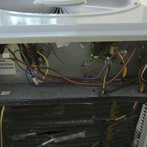 An Air Conditioner Opened for Repairs.