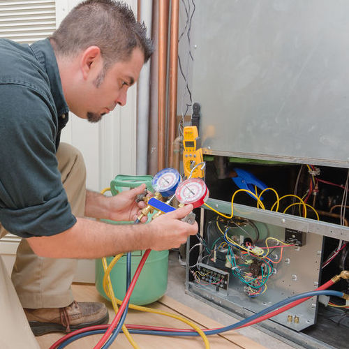 A Technician Tests HVAC Refrigerant Levels.