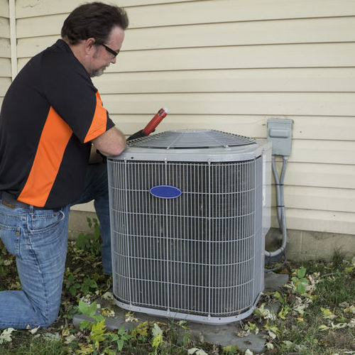 A Technician Repairs an Air Conditioning Unit.
