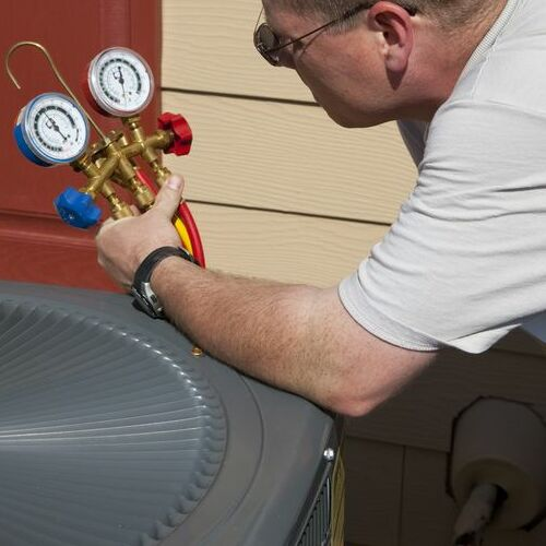 An HVAC Technician Tests an Air Conditioner.